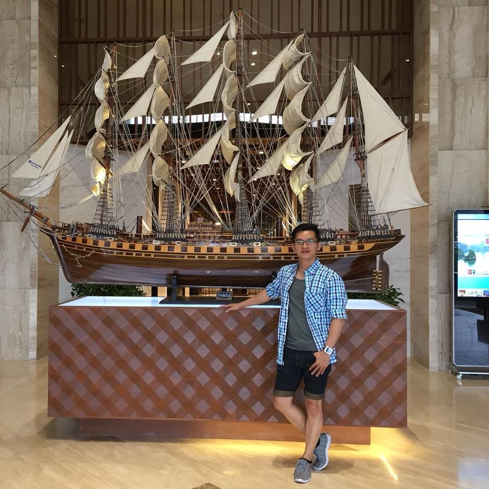 Kevin standing beside the Ship model